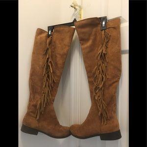 Knee high fringe boots